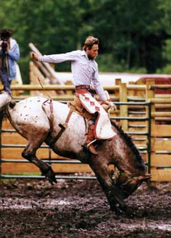 Owner Rick Guinn riding saddle bronc