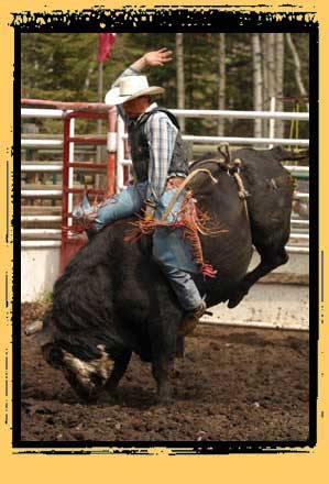 Billy Richards riding a bull at a convention rodeo